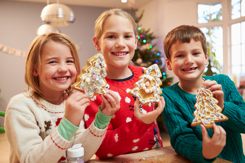 http://www.dreamstime.com/stock-images-three-children-showing-decorated-christmas-cookies-camera-smiling-image41521224