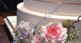 Wedding cake with lace and roses