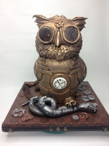 Steam Punk Owl Cake on a plain white background.  Note the lack of wrinkles. Levolor blind!